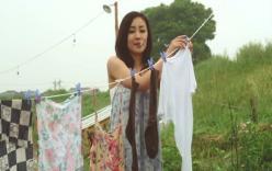 洗濯物を干しててる田村圭子