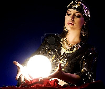 s-7113279-fortune-teller-reads-the-future-in-glowing-crystal-ball.jpg