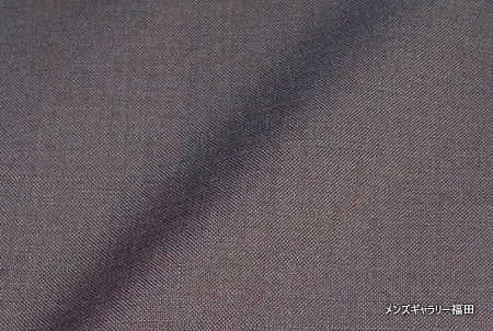 サマーキッドモヘアの玉虫色の服地