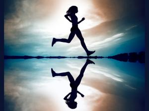 Female_runner_silhouette_is_mirrored_below_with_a_soft_pastel_sunset.jpg