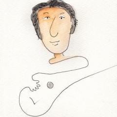 ギターを弾くYsan