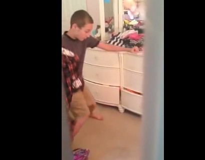 Boy caught dancing to Britney Spears