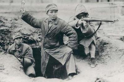 chinese nationalist army soldiers using rifles and a grenades during the battle of shanghai (july 1937)