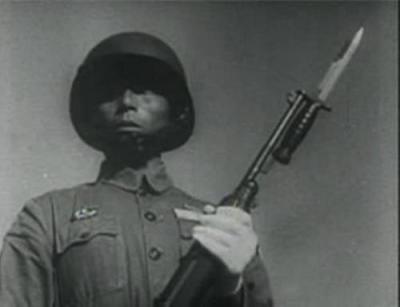 chinese nationalist army soldier with a bayonet attached to his gun (china 1944)