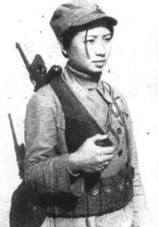 female soldier from guerrila unit armed with a mauser pistol (china 1939)