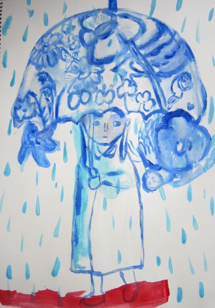 雨の日に、傘の中に広がる夢