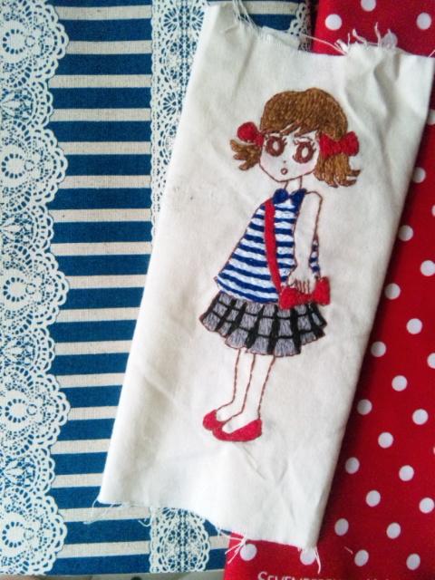 赤いリボン刺繍布と女の子