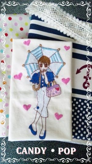 布合わせ縮小日傘の女の子