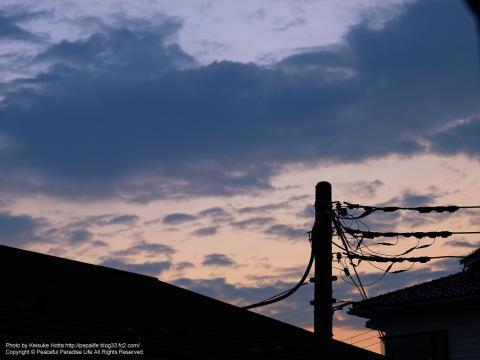 夕焼け空と屋根